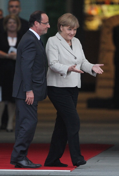 German Chancellor Angela Merkel welcomes French President Francois Hollande at the Chancellery hours after Hollande's inauguration in Paris on May 15, 2012 in Berlin. Source: Getty Images