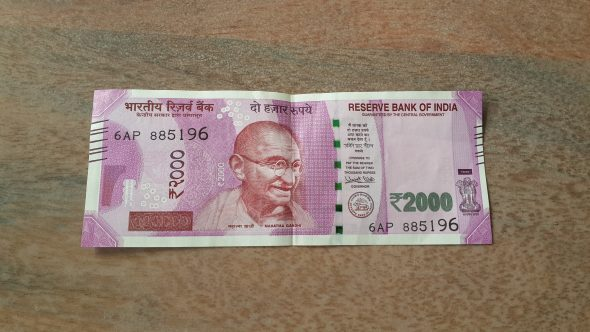 The new 2000 rupee note, courtesy of an office-mate and unbroken despite her best efforts